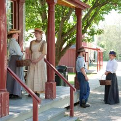 Actors dressed in period-specific clothing at Doon Heritage Village at the Waterloo Regional Museum