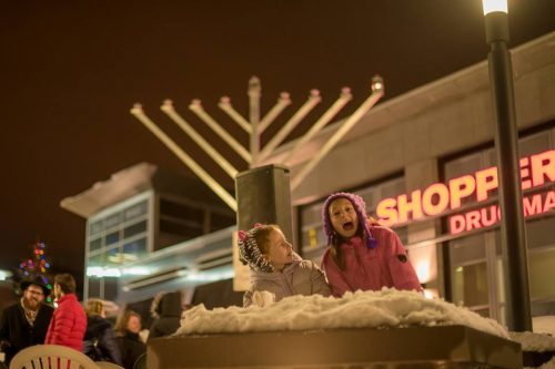 two girls in front of the menorah at Waterloo Public Square