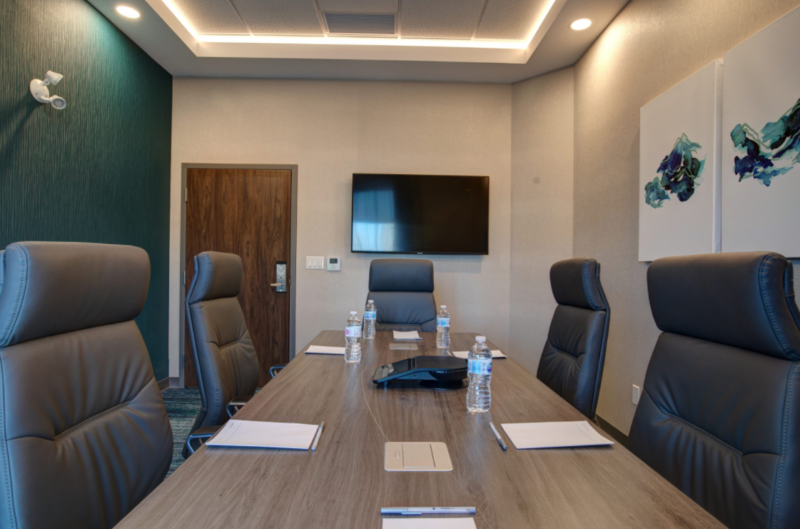 board room with table and chairs at the Hampton Inn and Suites St.Jacobst.