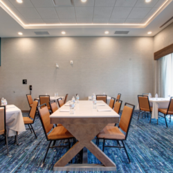 meeting room with tables and chairs arranged at Hampton Inn and Suites St. Jacobs