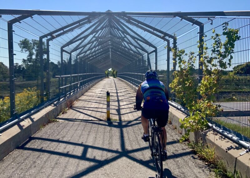 cycling over the 401 on the pedestrian and cycling bridge during the Ontario by Bike Waterloo Guelph Explorer