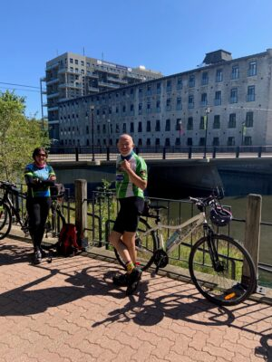 Cyclists enjoying a stop along the Grand River in Cambridge during the Ontario by Bike Waterloo Guelph Explorer