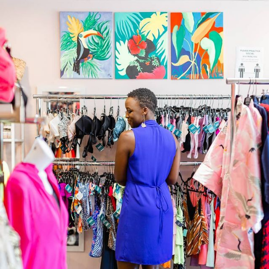 BIPOC Shopper looking at clothing at a retailer in Waterloo Region