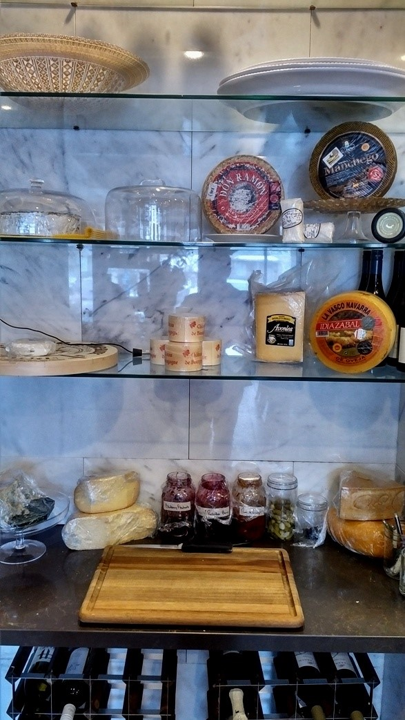 a variety of cheeses and preserves, lining the shelves in what's called the Cheese Cave at Public Kitchen and Bar in Kitchener