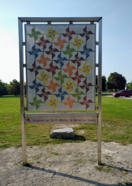 Urban art piece at the head of the Health Valley Trail in St. Jacobs that looks like a quilt and is constructed with coloured marbles