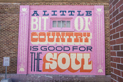 mural painted on the side of the old post office in St. jacobs that reads A Little Bit of Country is Good For the Soul