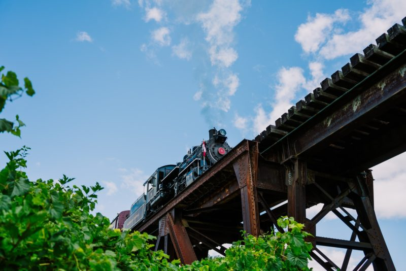 Steam engine crossing over the river on the historic St. Jacobs Railway Viaduct