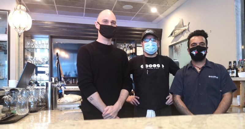 Chefs Shawn Flanagan, Ryan Murphy and Sourabh Gandotra wearing PPE masks and standing together at Public Kitchen and Bar restaurant in Kitchener