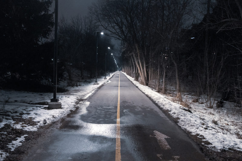a nigh time view in the winter of a secion of the Iron Horse Trail in Kitchener