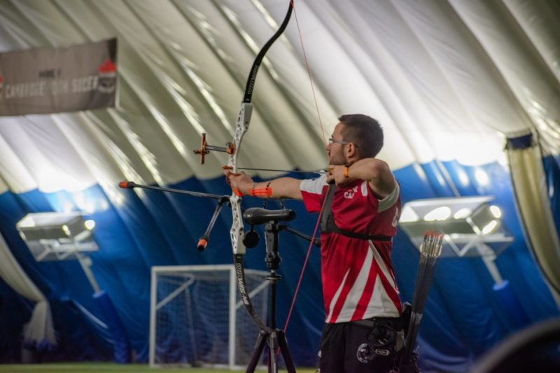 Member of Archery Canada's high performance Recurve program taking aim at a target during a training camp at the ComDev Centre in Cambridge