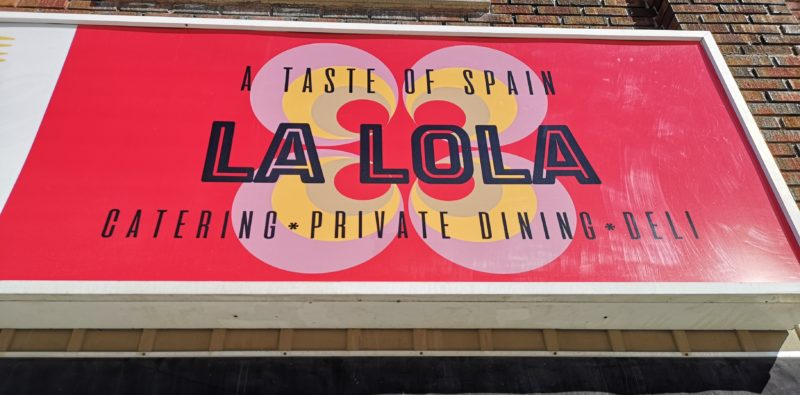 the colourful sign at La Lola Catering in Cambridge