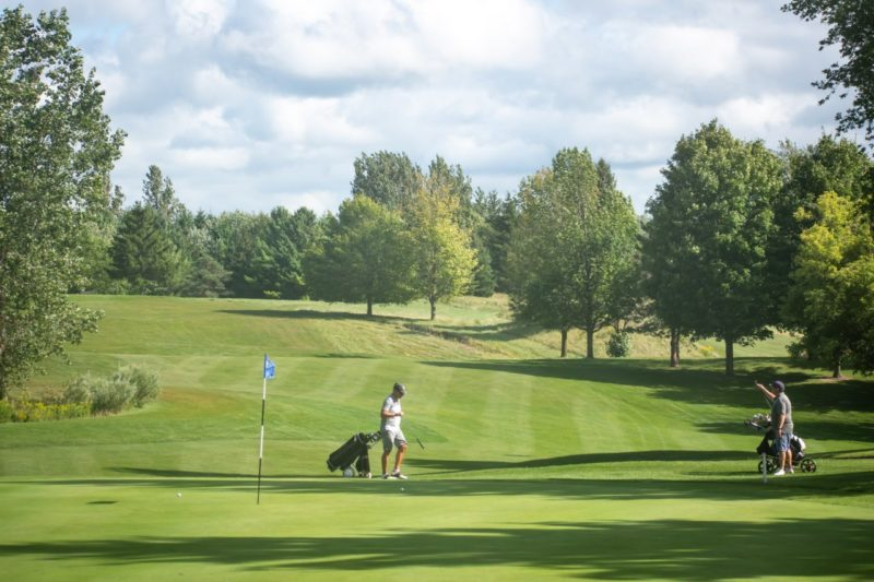 two golfers on the course at Foxwood Golf and Country Club in Baden, Ontario on a sunny summer's day