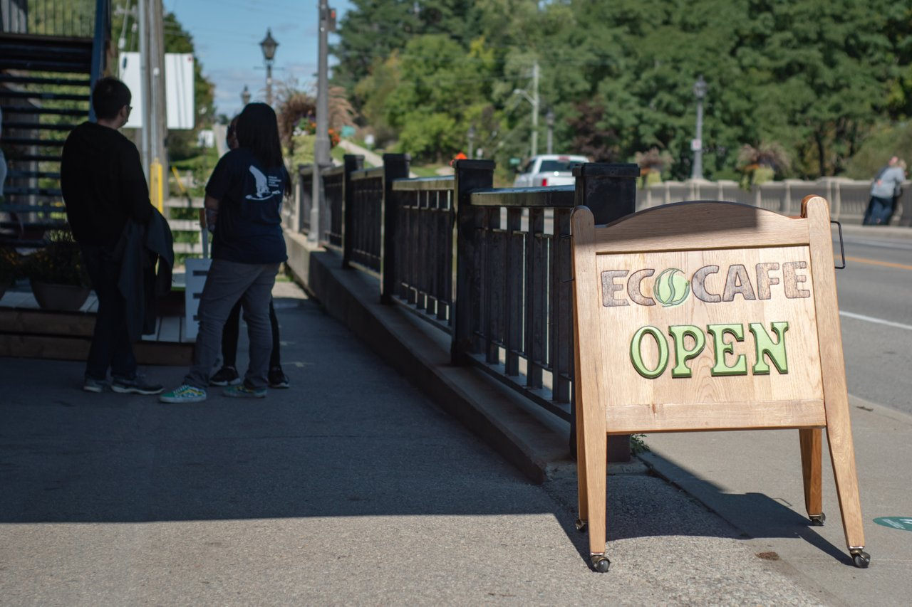 The Open sign outside o the sidewalk by the takeout window at EcoCafe Coffee Roasters in St. Jacobs