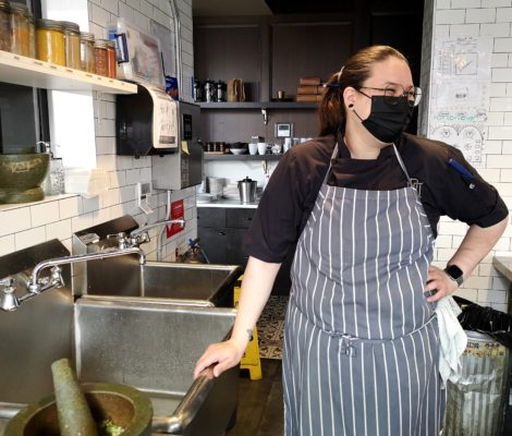 chef Annie Street in the kitchen standing by the sink at Loloan Lobby Bar in Uptown Waterloo