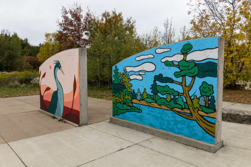 two colourful Indigenous art installations at the entrance to Huron Natural Area in Kitchener (installations created by artist Luke Swinson, August Swinson and Tsista Kennedy)