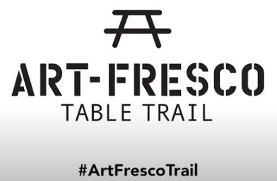 drawing of a wooden picnic table with the words Art Fresco Table Trail written underneath it along with the hashtag Art Fresco Trail