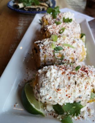 a photo of plated Elote, or Mexican, Street Corn