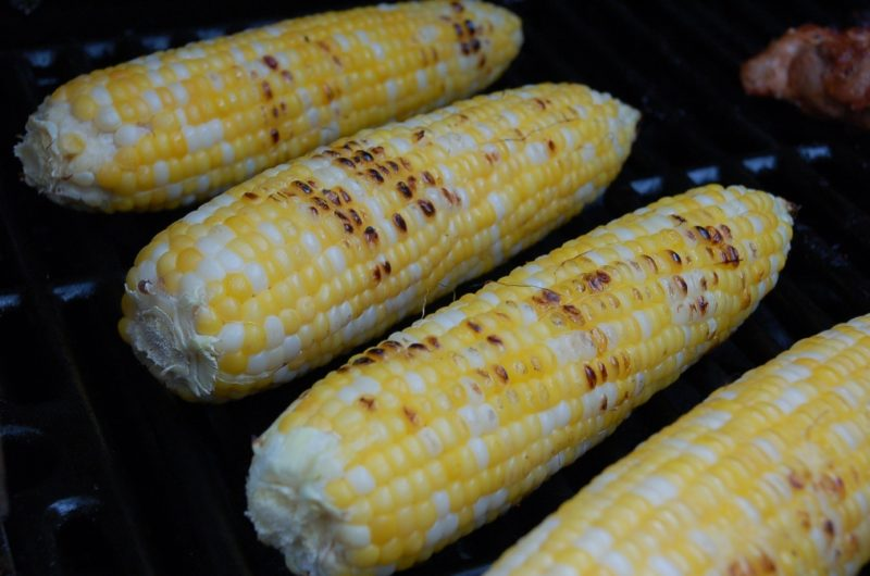 corn on the cob being grilled on a barbeque