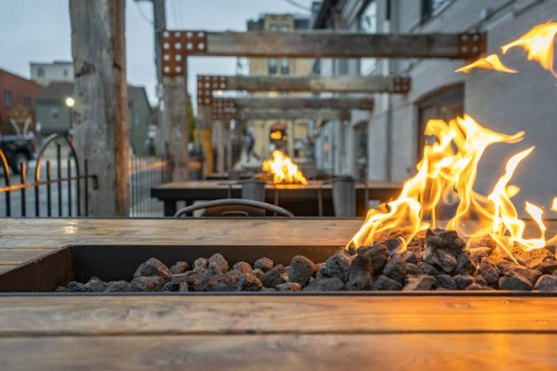 The outdoor fire tables lit up on the patio at Prohibition Warehouse in Waterloo