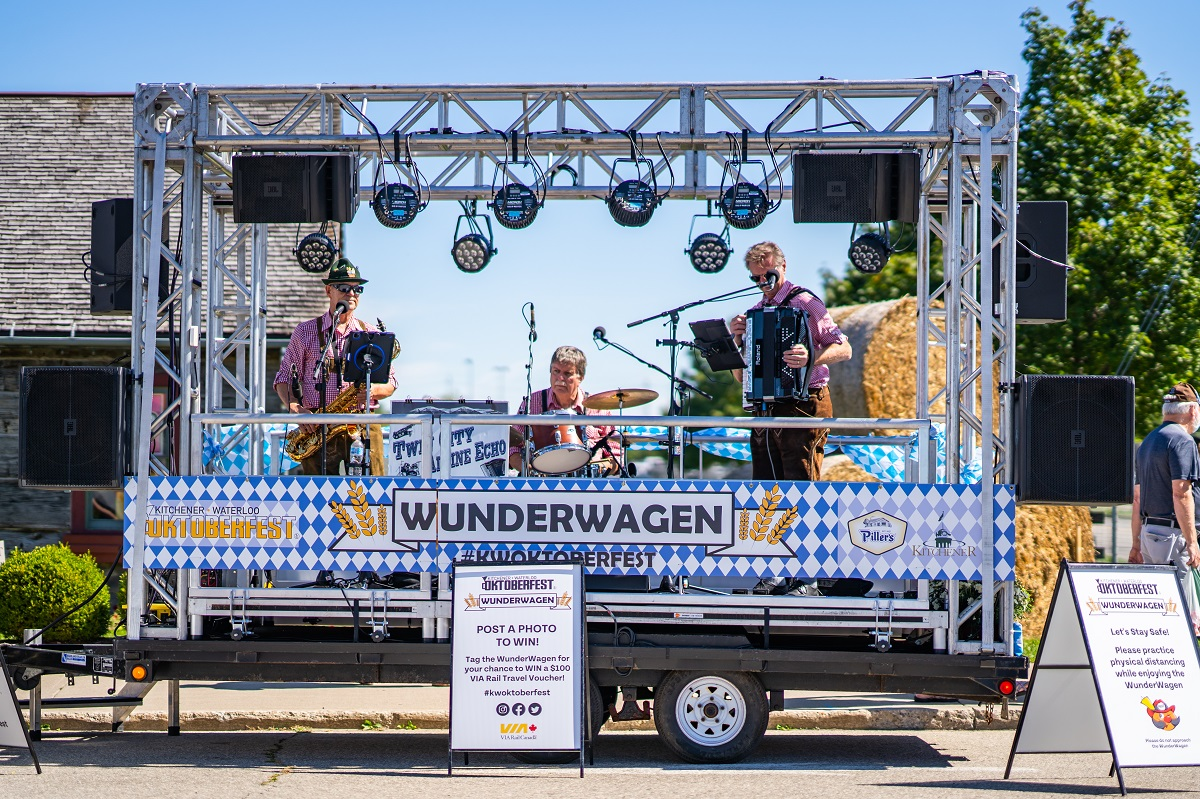a portable stage on a flatbed with a band playing on it